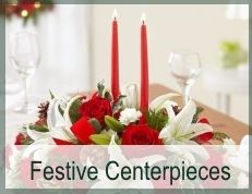 Elegant Table Arrangements, Candle-lit Centerpieces, featuring scented holiday greens and favorite Holland flowers in Christmas colors. Same-day flower delivery across Atlanta and USA.