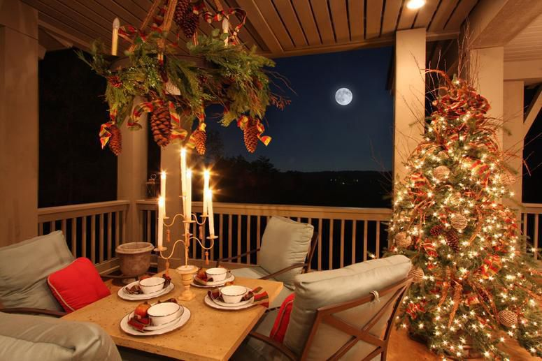 outdoor porch decorated for christmas garland mantle candles by carithers flowers